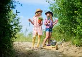 Adorable Girls In Hats Going Planting Plants. Kids Siblings Having Fun At Farm. Taking Care Of Plant poster