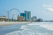 Resorts, ocean, and ferris wheel in Myrtle Beach, South Carolina. poster