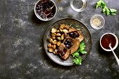 Slow Cooked Beef With Mushrooms And Blueberry Sauce On Dark Stone Background With Free Text Space. T poster