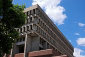 picture of city hall  - looking up at boston city hall showing its angular shape with clouds and tree - JPG
