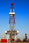 pic of oil drilling rig  - A land drilling rig in China Shengli Oil Plant - JPG