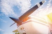 Close Up Airplane Propeller With Sun Flare On Sky Background poster