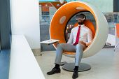 Peaceful Businessman In Vr Headset Enjoying Virtual Video. Man In Office Clothes And Virtual Reality poster