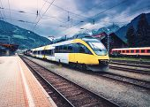 Beautiful High Speed Train On The Railway Station In Mountains At Sunset In Autumn Yellow Modern Com poster