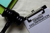 Gender Discrimination Document Form And Black Judges Gavel On Office Desk. Law Concept poster
