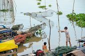 CHAU DOC, VIETNAM - JANUARY 2: Unidentified fisherman's children play on their boat waiting for the