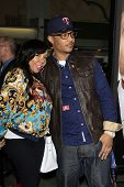 LOS ANGELES - FEB 4:  T.I., aka Clifford Joseph Harris Jr., wife Tiny, aka Tameka Harris arrive at t
