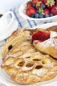 Continental breakfast.  Variety of pastries with fresh fruit and coffee.