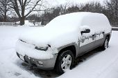 Blizzard Covers SUV with Snow