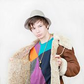 stock photo of pimp  - Teenage boy pimp in gang style with coat and hat - JPG