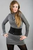 portrait of brunette in a gray slinky dress