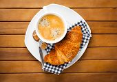Coffee Cup With Lump Sugar And Croissant, Wooden Background