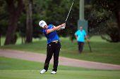 KUALA LUMPUR - OCTOBER 12: Jiyai Shin of South Korea hits the ball to the 2nd hole green of the KLGCC course on Day 3 of the Sime Darby LPGA on October 12, 2013 in Kuala Lumpur, Malaysia.