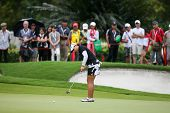 KUALA LUMPUR - OCTOBER 12: jee Young Lee of South Korea putts at the 2nd hole green of the KLGCC cou