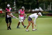 KUALA LUMPUR - OCTOBER 12: So Yeon Ryu of South Korea collects her ball from the 2nd hole of the KLG