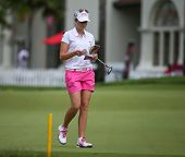 KUALA LUMPUR - OCTOBER 12: Paula Creamer of USA checks her notes on the 2nd hole green of the KLGCC