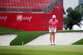 KUALA LUMPUR - OCTOBER 12: Stacy Lewis of USA putts on the 2nd hole green on Day 3 of the Sime Darby