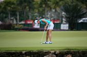KUALA LUMPUR - OCTOBER 12: Michele Wie of USA putts on the 2nd hole green of the KLGCC course on Day 3 of the Sime Darby LPGA on October 12, 2013 in Kuala Lumpur, Malaysia.