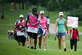 KUALA LUMPUR - OCTOBER 12: Brittany Lang and Jodi E. Shadoff (green) walk to the Hole 2 green of KLG