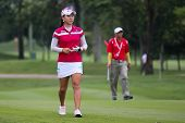 KUALA LUMPUR - OCTOBER 12: Hee Young Park of South Korea walks to the Hole 2 green of KLGCC course on Day 3 of the Sime Darby LPGA on October 12, 2013 in Kuala Lumpur, Malaysia.