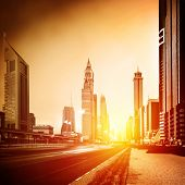 Dubai city in sunset, bright yellow sun light, beautiful panorama of modern architecture, financial center, luxury district, business city concept