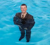 Senior Business Man In Deep Water