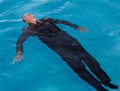 Senior Man Floating On Back In Water