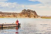 A couple on a honeymoon road trip at Lake Powell