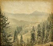 foto of hazy  - Retro image of winter landscape in the carpathians mountains - JPG