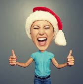 funny picture of screaming woman in santa hat