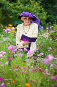 Stylish Senior Woman Reading Outdoors