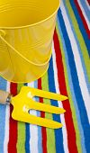 Stripy Beach Towel Yellow Bucket And Fork.