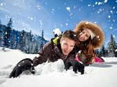 stock photo of snowball-fight  - Portrait of joyful woman throwing snowball at man - JPG