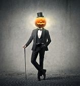 stock photo of calabash  - elegant man wearing suit and cylinder for the Halloween party - JPG