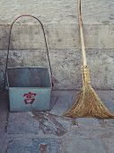Old Broom And Dust Pan On Beijing Street