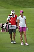 KUALA LUMPUR - OCTOBER 13: Paula Creamer of USA discusses with her caddy on the next play at the KLG