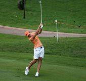 KUALA LUMPUR - OCTOBER 13: Carlota Ciganda of Spain hits the ball to the 2nd hole green of the KLGCC