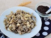 foto of hungarian  - Traditional Hungarian noodles with ground poppy seeds and sugar - JPG