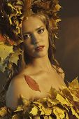 Young Woman With Yellow Leaves
