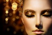 Beauty Fashion Model Girl with Holiday Leopard Makeup. Golden Wild Cat Eyes Make-up Eyeshadow. Beaut