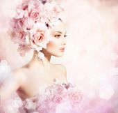 Fashion Beauty Model Girl with Flowers Hair. Bride. Perfect Creative Make up and Hair Style. Hairsty