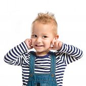 Boy Covering His Ears Over White Background.
