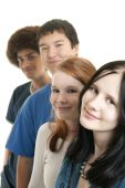 picture of ethnic group  - Four teens of different ethnic backgrounds smiling - JPG