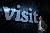 The word visit and serious businessman with hands on hips against futuristic black and blue background