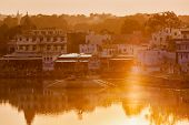 PUSHKAR, INDIA - NOVEMBER 21, 2012: Sacred Puskhar lake (Sagar) and ghats of  town Pushkar on sunset