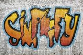 simplify  word -  graffiti style text on an old grunge plaster wall, GRAPHICS CREATED BY THE PHOTOGRAPHER