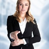Closeup portrait of attractive business woman stretches out her hand for a handshake with partner, m