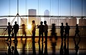 stock photo of city silhouette  - Group of Business People in Office Building - JPG