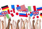 stock photo of irish flag  - Diverse Hands Holding International Flags - JPG