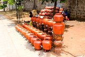 Terracotta water pots being sold at road side to wade through the summer